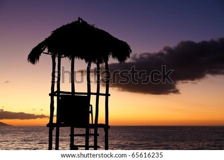 Silhouette of a lifeguard tower on Los Muertos beach against sunset sky. Puerto Vallarta, Mexico - stock photo