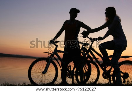 silhouette of a loving couple at - stock photo