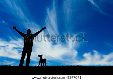 Silhouette of a man and his dog. - stock photo