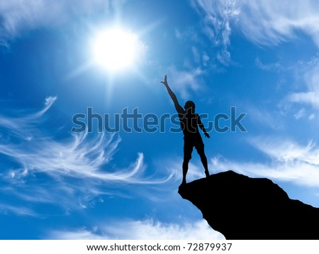 silhouette of a man at the top of the mountain against the sky - stock photo