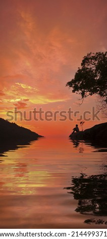 silhouette of a man contemplating - digital composite,  water reflection and ripple effects.  - stock photo