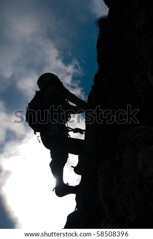 Silhouette of a man during an ascension in Retezat mountains. - stock photo