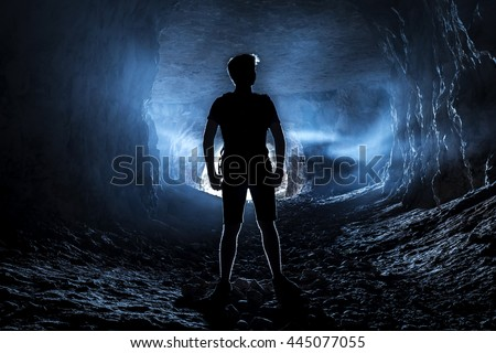 Silhouette of a man in a cave