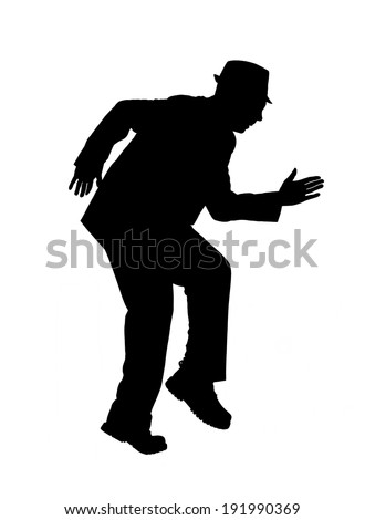 Silhouette of a man in a suit and hat creeping along as if sneaking up on someone isolated on white. - stock photo
