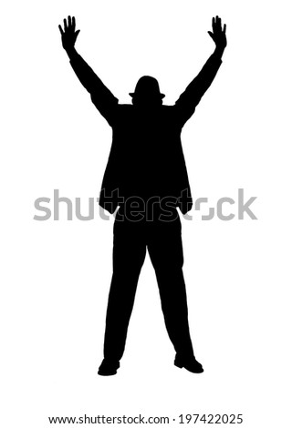 Silhouette of a man in a suit and hat with arms outstretched as if making a  blessing or trying to signal someone of danger or to stop. - stock photo