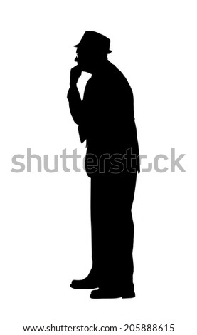 Silhouette of a man in a suit and hat with hand on chin and looking as if deep in thought or observation isolated on white. - stock photo