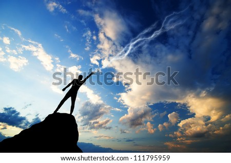 silhouette of a man on a mountain top manufactures of hand zipper. natural composition