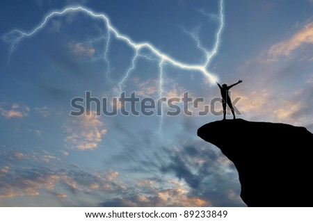 silhouette of a man on a mountain top manufactures of hand zipper. natural composition - stock photo
