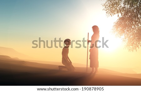 Silhouette of a man on his knees before Jesus. - stock photo