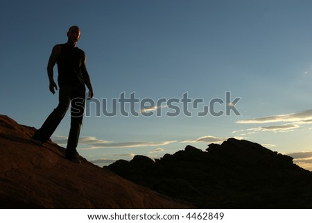 Silhouette of a man on mountain top