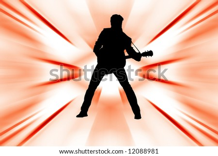 Silhouette of a man playing acoustic guitar