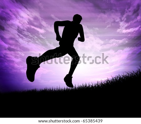 Silhouette of a man running against the evening sky - stock photo