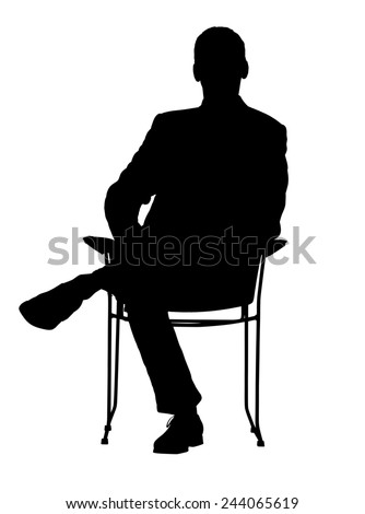 Silhouette of a man sitting in a modern armchair with one leg over his knee.  - stock photo
