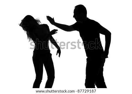 Silhouette of a man slapping a woman depicting domestic violence isolated against white background - stock photo