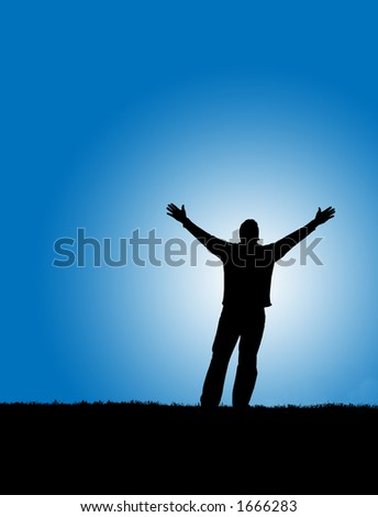 Silhouette of a man with arms lifted up to the sky. - stock photo