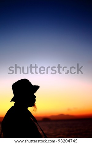 Silhouette of a man with beard and hat during a beautiful sunrise