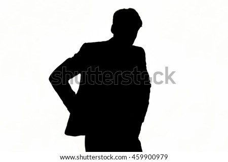 Silhouette of a man with his hands in his pockets