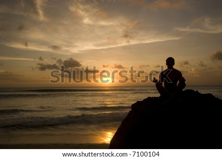 Silhouette of a meditating man.