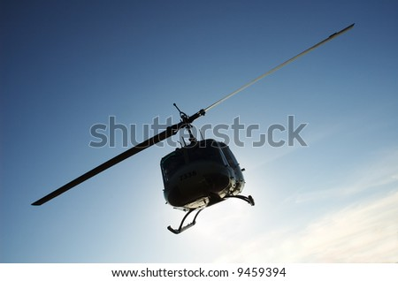 Silhouette of a military helicopter on a mission