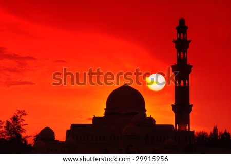 Silhouette of a mosque. Beautiful sun setting at Floating Mosque, Terengganu, Malaysia.