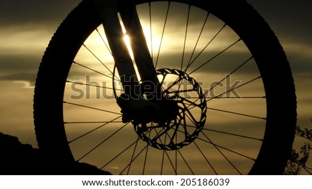 Silhouette of a mountain bike wheel - stock photo