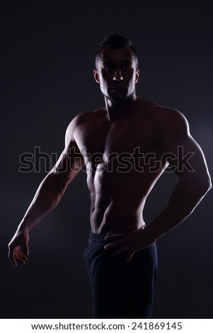 Silhouette of a muscular man - stock photo
