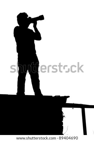 Silhouette of a photographer man outdoor