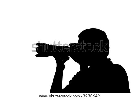 Silhouette of a photographer taking a picture - stock photo