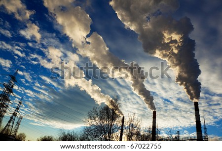 silhouette of a pipe with smoke - stock photo