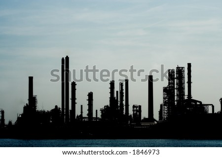 Silhouette of a power plant at Antwerp harbor - stock photo