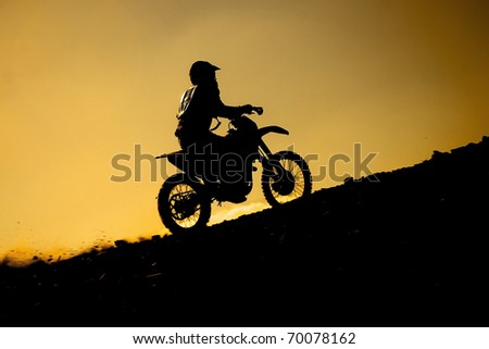 silhouette of a rider at sunset - stock photo