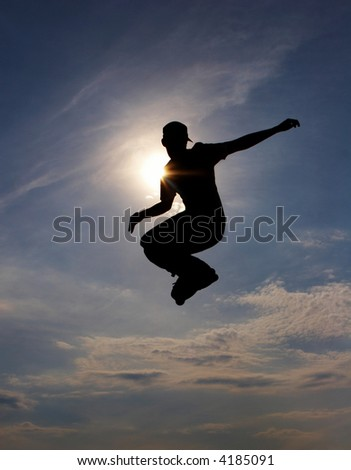 silhouette of a roller skater - stock photo