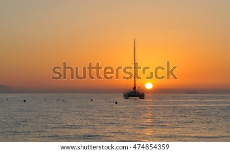 Silhouette of a sailing boat at sunset