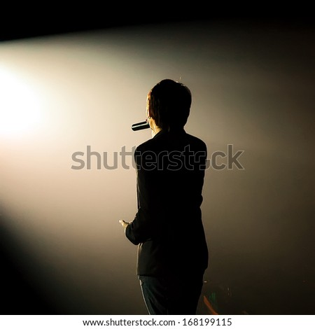 silhouette of a Singing of a pop band - stock photo