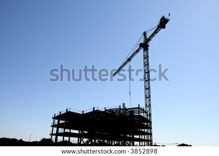 Silhouette of a Skyscraper Under Construction - stock photo