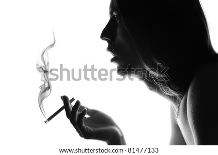 Silhouette of a smoker with a cigarette. - stock photo