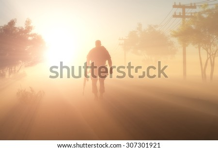 Silhouette of a soldier in the fog. - stock photo