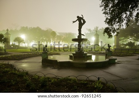 Silhouette of a Statue and Fountain at night in Audubon Park, New Orleans, Louisiana. - stock photo