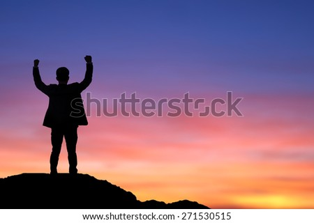 Silhouette of a success business call phone . Shot outdoor at sunrise - stock photo
