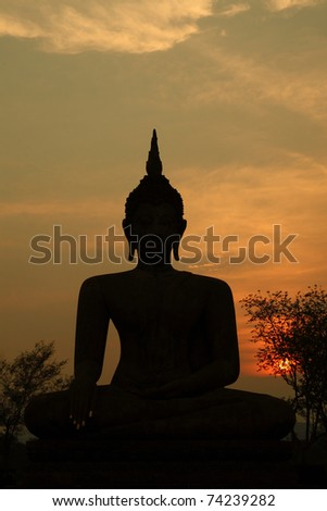 Silhouette of a Sukhothai buddha in Sukhothai historical park, thailand - stock photo