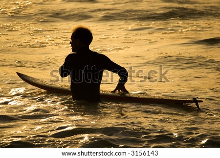 Silhouette of a surfer - stock photo
