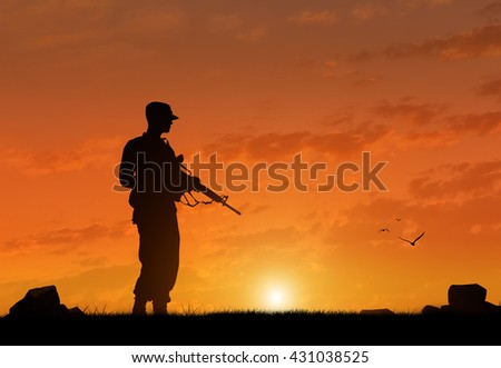 Silhouette of a terrorist with a weapon at sunset. The concept of terrorism and war