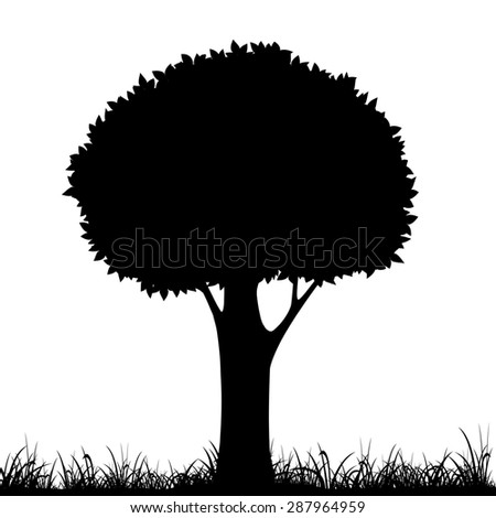 silhouette of a tree and grass. Stock image.