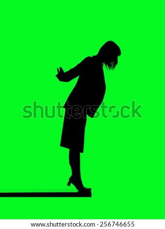 Silhouette of a woman close to fall down isolated on green background
