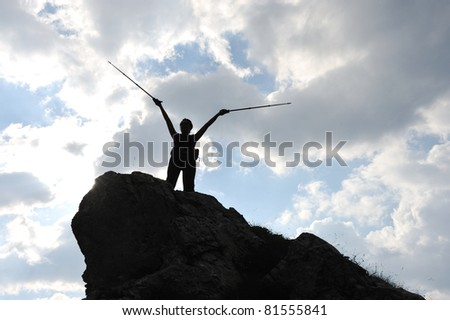 Silhouette of a woman during and advantage climbing and mountain walking