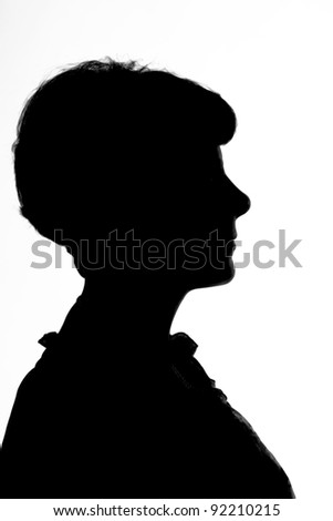 Silhouette of a woman in profile, close-up. Isolated on white - stock photo
