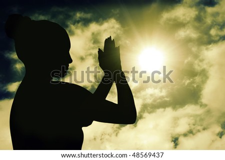silhouette of a woman meditating