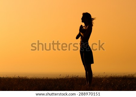 Silhouette of a woman meditating.Peace of mind - stock photo