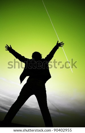 silhouette of a woman raising her arms out to the sky