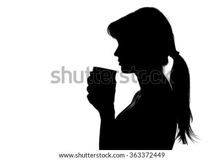 silhouette of a woman with a cup in hands